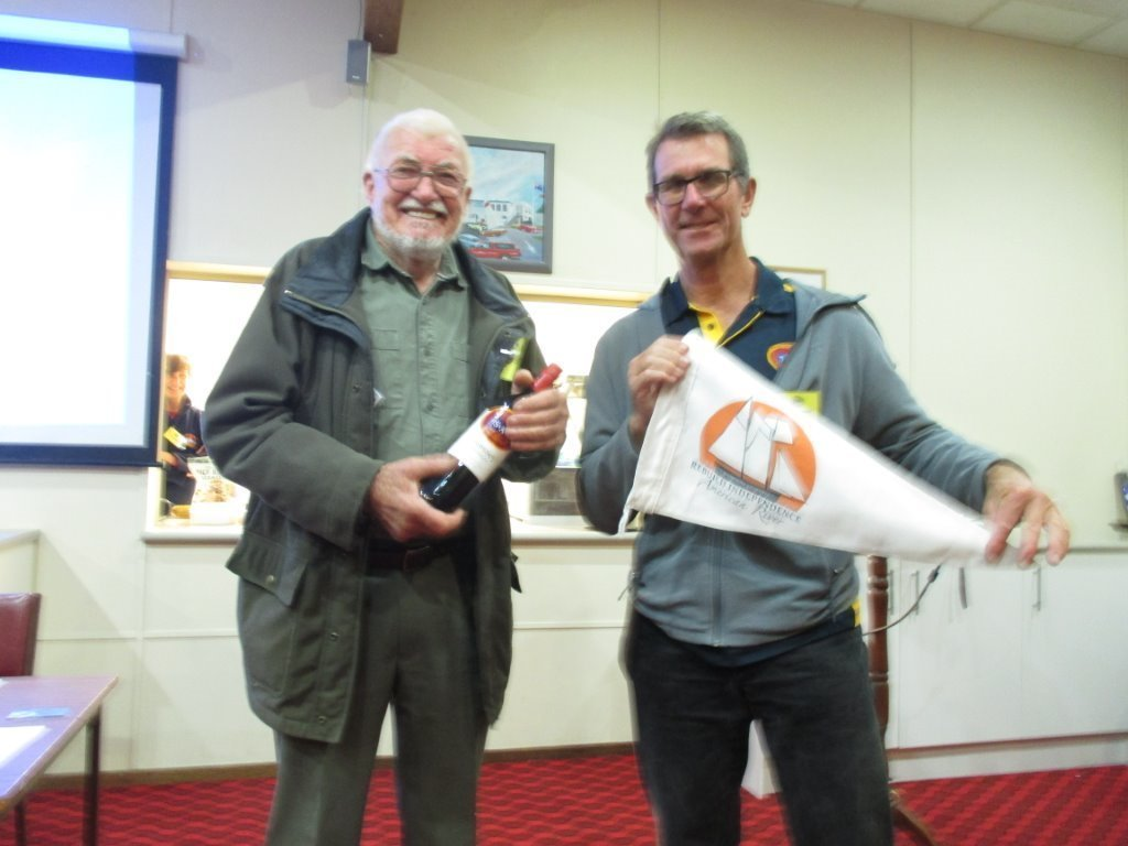 Tony presenting a RIG pennant to the President of TSASA, Steve Lewis